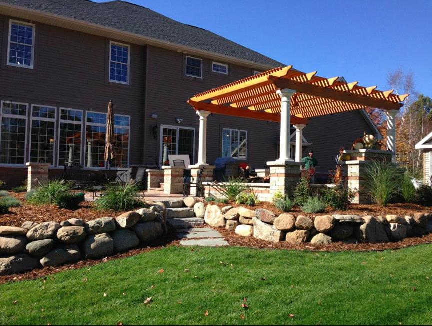 Stone Wall & Pergola backyard landscape design - Reder Landscaping, Midland MI